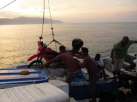 Unloading Rodney on to Walters lancha to reach the shores of Jaque.