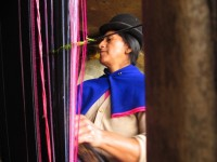 """I was very, very lucky to meet this woman deep in Guambia, here she weaves a Hanaco, a womans wrap dress on her """"Telar"""" a large wooden weaving frame.  I could write a lot more on this encounter."""